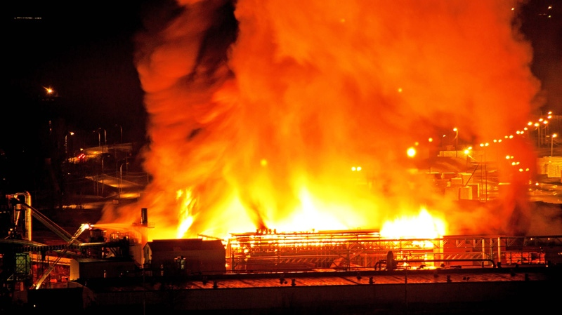 A large fire burns at the Lakeland Mills sawmill in Prince George, B.C., on Tuesday April 24, 2012. (Andrew Johnson / THE CANADIAN PRESS)