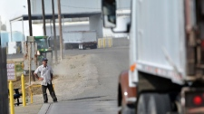 A truck leaves the plant at Baker Commodities transfer station where a cow with mad cow disease was discovered in Hanford, California, Tuesday, April 24, 2012. (AP / The Fresno Bee, John Walker )
