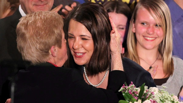 Wildrose Leader Danielle Smith receives a hug following her speech as her party placed second in the Alberta election in High River, Alberta, Monday, April, 23, 2012. (Jonathan Hayward / THE CANADIAN PRESS)