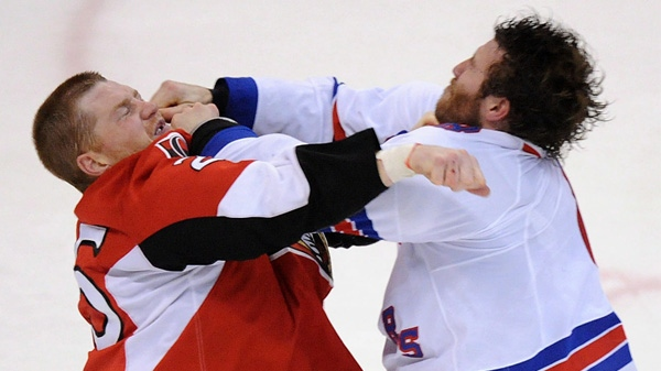 Ottawa Senators' Chris Neil fights New York Rangers' Brandon Prust during the first period of game six of first round NHL Stanley Cup playoff hockey action at the Scotiabank Place in Ottawa on Monday, April 23, 2012. THE CANADIAN PRESS/Sean Kilpatrick