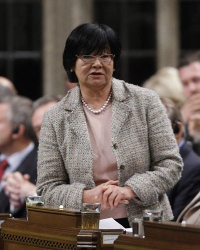 Minister of International Co-operation Bev Oda stands in the House of Commons during Question Period in Ottawa, Tuesday, April 24, 2012. (Adrian Wyld / THE CANADIAN PRESS)