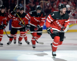 Canada's Josh Morrissey, right, celebrates after scoring the second goal against the USA during second period preliminary round hockey action at the IIHF World Junior Championship, December 31, 2014 in Montreal. (Ryan Remiorz / The Canadian Press)