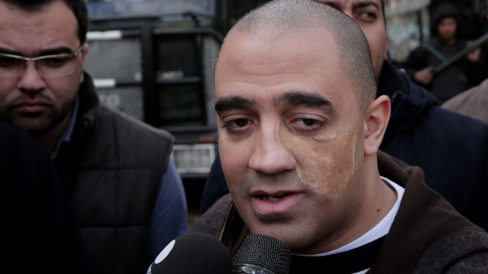 Adel Fahmy, the brother of Egyptian-Canadian Al-Jazeera English journalist Mohammed Fahmy, speaks to journalists as he leaves the high court after a hearing, in Cairo, Egypt, Thursday, Jan. 1, 2015. (AP / Nariman El-Mofty)