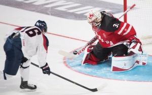 Canada's goaltender Zach Fucale makes a save against Slovakia's Robert Lantosi during first period preliminary round hockey action at the IIHF World Junior Championship in Montreal, December 26, 2014. (Graham Hughes / The Canadian Press)