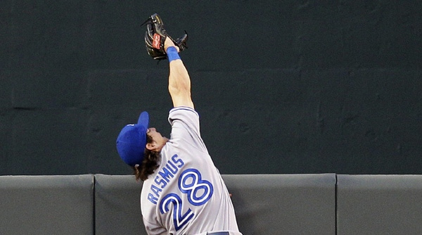 Toronto Blue Jays center fielder Colby Rasmus can't reach a solo home run ball hit by Baltimore Orioles' Wilson Betemit in the second inning of a baseball game in Baltimore, Wednesday, April 25, 2012. (AP Photo/Patrick Semansky)