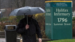 An unidentified man heads past the Halifax Infirmary in Halifax on Tuesday, April 24, 2012. THE CANADIAN PRESS/Andrew Vaughan