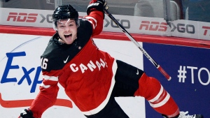 Canada's Max Domi celebrates after scoring the fifth goal against Team USA during third period preliminary round hockey action at the IIHF World Junior Championship on in Montreal on Wednesday, December 31, 2014. (Ryan Remiorz / THE CANADIAN PRESS)