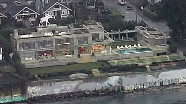 Chip Wilson's waterfront mansion in Point Grey, seen in this Chopper 9 file image, dropped in assessed value from $78.8 million to $73.1 million.