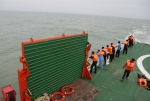 In this file photo, members of the National Search And Rescue Agency (BASARNAS) stand on KN SAR Purworejo ship on the Java Sea, Indonesia, Saturday, Jan. 3, 2015. (AP / Achmad Ibrahim)