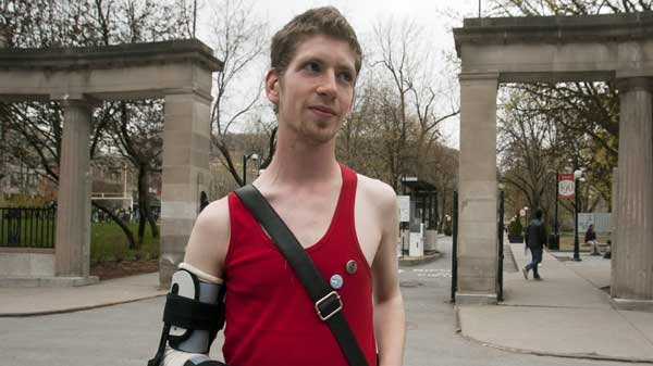 Student Ethan Feldman poses for a photo in front of McGill University Thursday, April 26, 2012 in Montreal. Feldman had his arm broken during a protest against tuition fee hikes THE CANADIAN PRESS/Ryan Remiorz