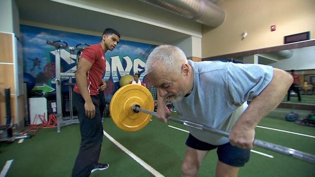 Senior lifts weights