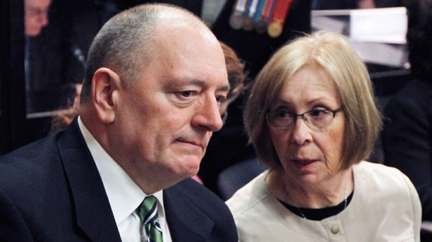 Shaun Fynes and his wife Sheila, parents of Cpl. Stuart Langridge, a soldier who killed himself in 2008, listen to testimony at a Public Interest Hearing at the Miliitary Police Commssion in Ottawa, Tuesday, March 27, 2012. (Fred Chartrand / THE CANADIAN PRESS_
