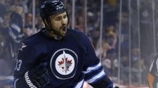 Winnipeg Jets' Dustin Byfuglien (33) his goal against the Toronto Maple Leafs during second period NHL action in Winnipeg on Saturday, January 3, 2015. (THE CANADIAN PRESS/John Woods)
