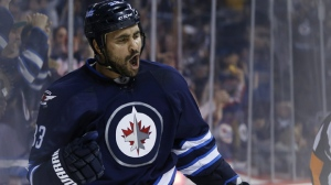 Dustin Byfuglien is a veteran of 869 NHL games, and had four goals and 27 assists in 42 games with the Jets last season. (Source: The Canadian Press/John Woods)