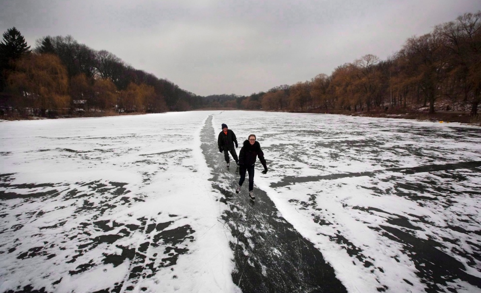 A couple skates on Grenadier Pond in Toronto's High Park on Dec. 29, 2010. (Darren Calabrese / THE CANADIAN PRESS)