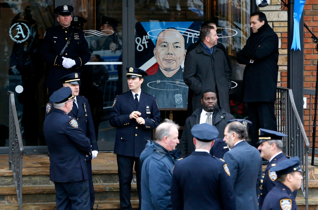 In Photos Sombre Funeral Held For Fallen Nypd Officer