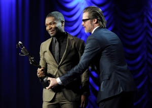 "Brad Pitt, right, presents the breakthrough performance award - actor to David Oyelowo for ""Selma"" at the 26th annual Palm Springs International Film Festival Awards Gala on Saturday, Jan. 3, 2015, in Palm Springs, Calif. (Photo by Chris Pizzello/Invision/AP)"