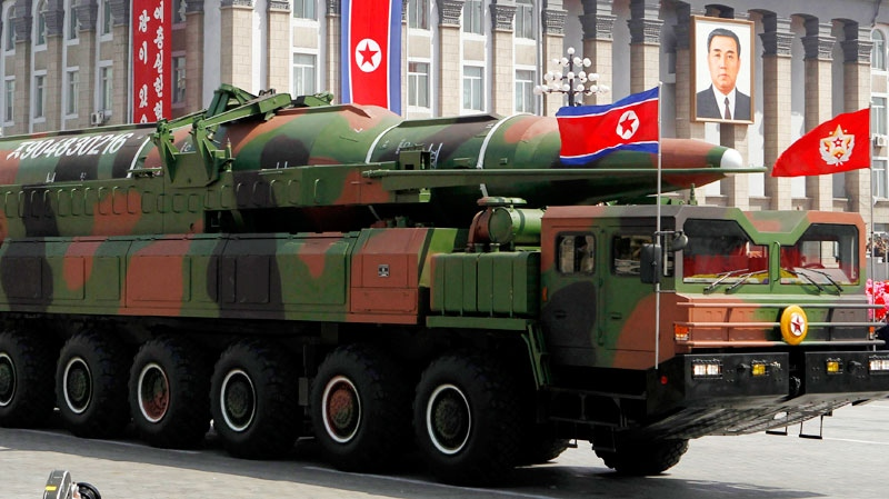 The White House is trying to tamp down concern over a new intelligence report showing North Korea could arm a ballistic missile with a nuclear warhead. (AP)