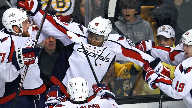 Washington Capitals right wing Joel Ward, center, is congratulated by teammates after his game-winning goal against the Boston Bruins during overtime of Game 7 of an NHL  Stanley Cup first-round playoff series in Boston, Wednesday, April 25, 2012. The Capitals won 2-1. (AP / Charles Krupa)