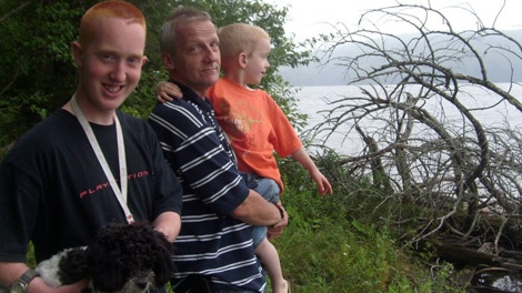 Taylor McNee, left, is seen with his family.
