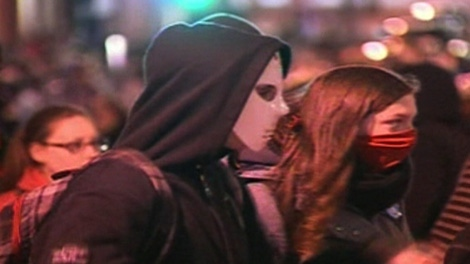 Masked students take part in a march in downtown Montreal on Wednesday, April 25, 2012.
