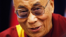 The Dalai Lama speaks at the 6th World Parliamentarians' Convention on Tibet in Ottawa on Friday April 27, 2012. (Adrian Wyld / THE CANADIAN PRESS)