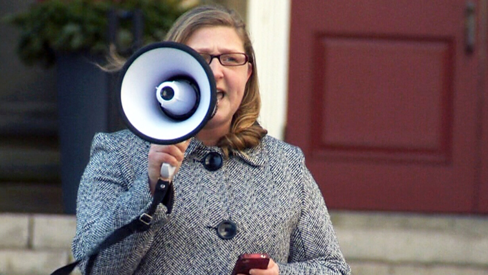 Dalhousie Student Union VP Jennifer Nowoselski speaks to students through a megaphone about the actions the school as taken in the wake of the scandal involving dentistry students on Jan. 6, 2015.