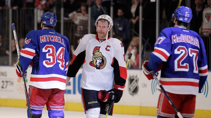 Ottawa Senators' Daniel Alfredsson, centre, shakes hands with New York Rangers' John Mitchell and Ryan McDonagh after the Rangers defeated the Senators 2-1 in Game 7 of a first-round NHL Stanley Cup playoff series on Thursday, April 26, 2012, in New York. (AP / Julio Cortez)
