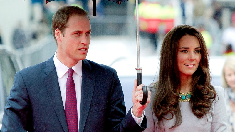 The Duke and Duchess of Cambridge arrive under an umbrella for the UK Premiere of 'African Cats', in aid of 'Tusk Trust', at the BFI Southbank in central London, Wednesday, April 25, 2012. (AP / Joel Ryan)