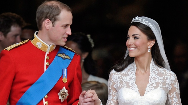 Prince William and his wife Kate, Duchess of Cambridge, stand outside of Westminster Abbey after their royal wedding in London, April 29, 2011. (AP / Martin Meissner)