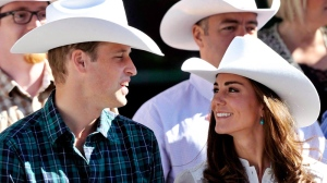 The Duke and Duchess of Cambridge watch the annual Calgary Stampede parade in Calgary on July 8, 2011. (Nathan Denette / THE CANADIAN PRESS)