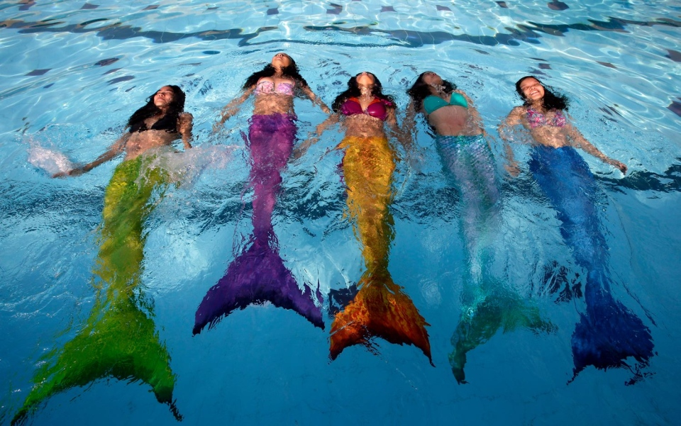 A group of participants are shown at Montreal's Aquamermaid Academy in this handout photo.