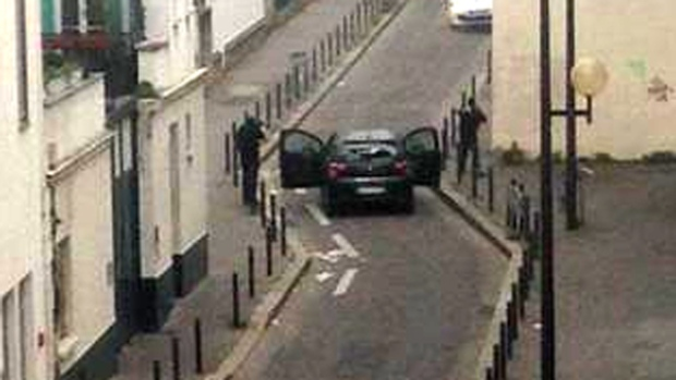 First known picture of the shooters outside the newspaper Charlie Hebdo in Paris, Wednesday, Jan. 7, 2015. (Twitter)