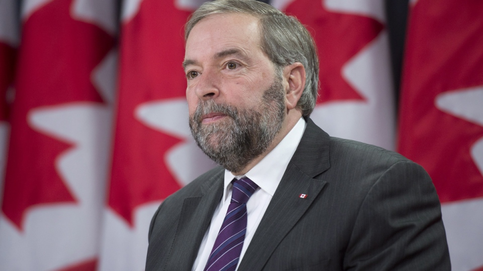 NDP Leader Tom Mulcair reacts to the shooting in France during a news conference, in Ottawa, Wednesday, Jan. 7, 2015. (Adrian Wyld / THE CANADIAN PRESS)