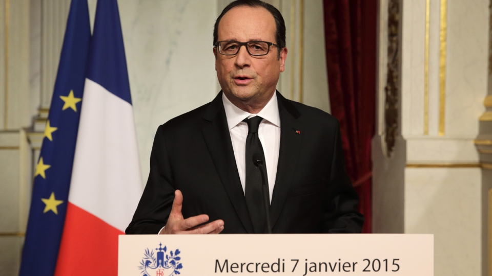 French President Francois Hollande delivers a speech at the Elysee Palace in Paris after a shooting at the Paris headquarters of satirical weekly Charlie Hebdo killing at least 12 people, Wednesday, Jan. 7, 2015. (AP / Philippe Wojazer)