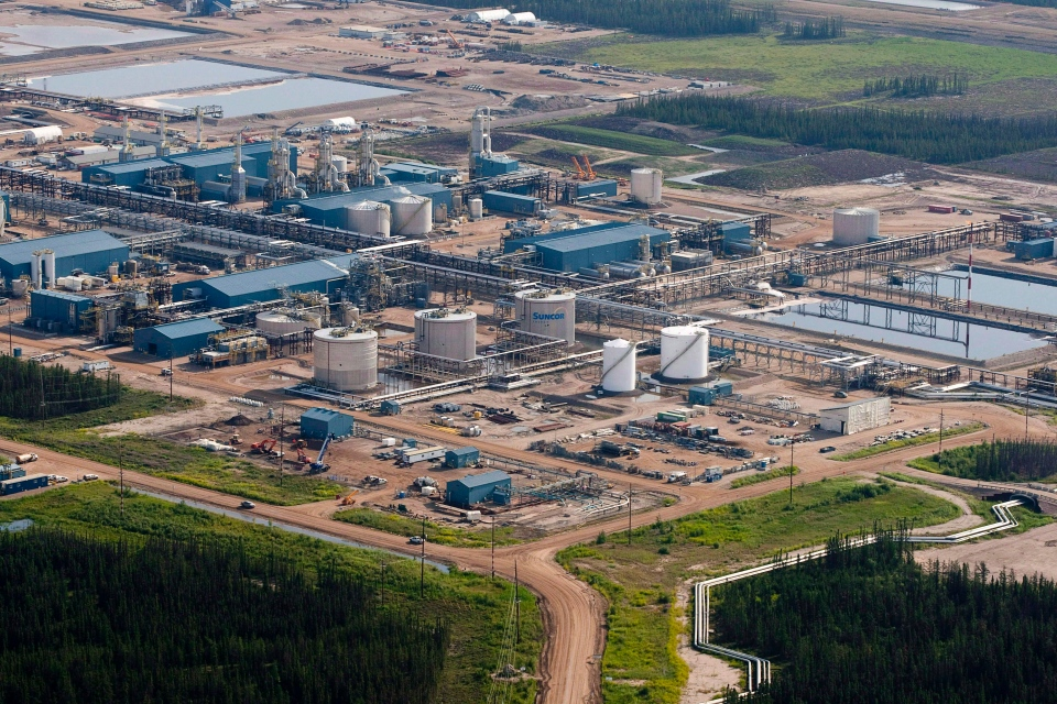 A Suncor oil sands facility is pictured near Fort McMurray, Alta., on July 10, 2012. (Jeff McIntosh / The Canadian Press)