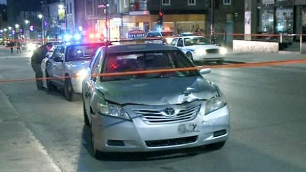 Police investigate after a taxi ran over a man in Montreal early Sunday, April 29, 2012.