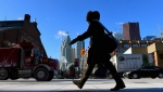 A woman walks in downtown Toronto on Wednesday, Jan. 7, 2015. (Frank Gunn/THE CANADIAN PRESS)