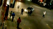 A taxi is surrounded by people moments before striking a man and running him over in Montreal early Sunday, April 29, 2012.
