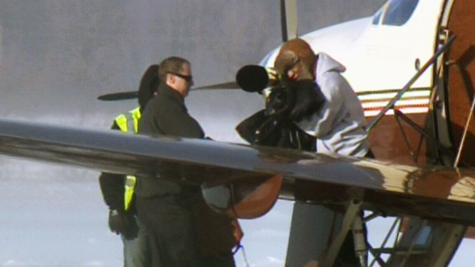 Comedian Bill Cosby walks off a plane and into a vehicle after arriving at Region of Waterloo International Airport, in Waterloo, Ont., Wednesday, Jan. 7, 2014.