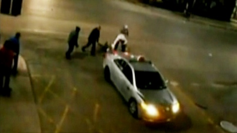 A taxi is seen moments after striking and running over a man in Montreal early Sunday, April 29, 2012.