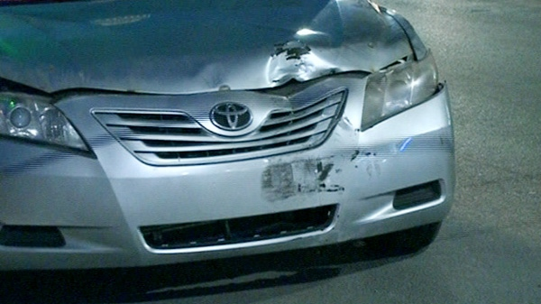 The front of a taxi is show after it ran over a man in Montreal early Sunday, April 29, 2012.