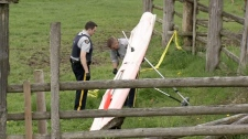 B.C. RCMP collects evidence from a crime scene following the death of a hang glider in Agassiz on Saturday, April 28, 2012.