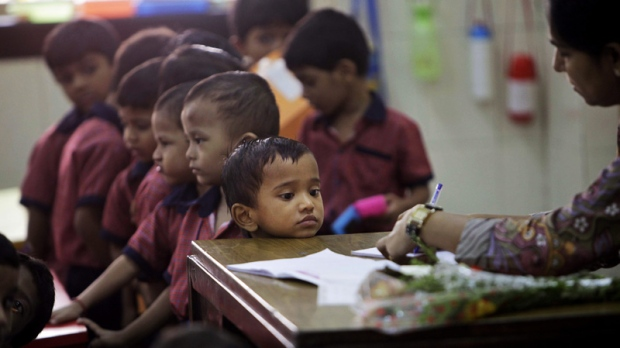 In this July 15, 2011 file photo, a student watches a teacher write inside a classroom at the Antonio Da Silva High School at Dadar in Mumbai, India. (AP Photo/Rajanish Kakade)