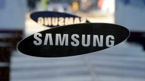 A logo of Samsung Electronics is seen at its showroom in Seoul, South Korea, Thursday, Jan. 8, 2015. (AP/Lee Jin-man)