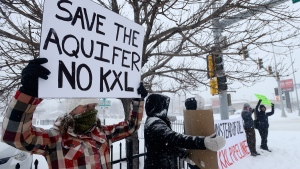 Valerie Schonewill and several others protest the proposed Keystone XL pipeline, on Jan. 5, 2015, in Sioux Falls, S.D. (AP / Argus Leader, Elisha Page)