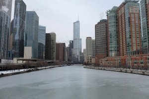 Ice forms over the Chicago River in downtown Chicago, on Thursday, Jan. 8, 2015. (AP / Kiichiro Sato)