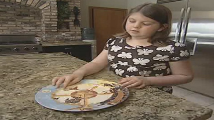 Bridget Osborne shows the special plate she uses to measure out her food portions.