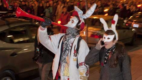 Thousands of students, many wearing masks and blowing horns, take to the streets of Montreal for the 7th night in a row protesting tuition fee hikes on Monday, April 30, 2012. The crowd had a festive atmosphere as they walked the downtown area followed closely by police. THE CANADIAN PRESS/Peter McCabe