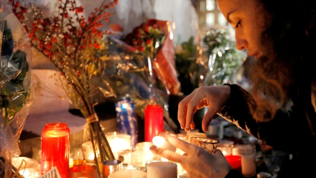 A girl lights candles during the solidarity demonstration in Paris, Thursday, Jan.8, 2015. (AP / Francois Mori)